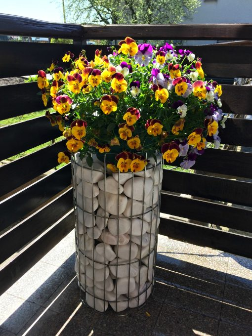 Gabion pillar with flowers on the balcony